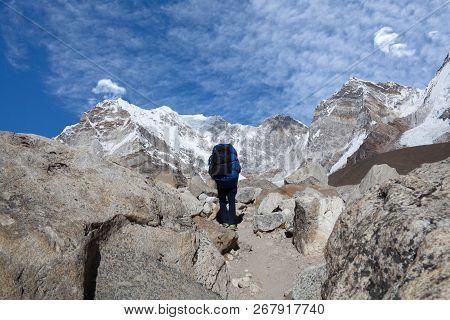 Tourists Walking On The Road To Everest Base Camp In Sagarmatha National Park, Nepal Himalaya