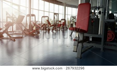 Blurred Empty Gym. Panoramic Picture - Modern Gym Interior With Equipment.