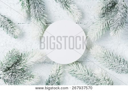 Snowy Christmas Fir Tree On White Wooden Table Top View. Flat Lay Style.