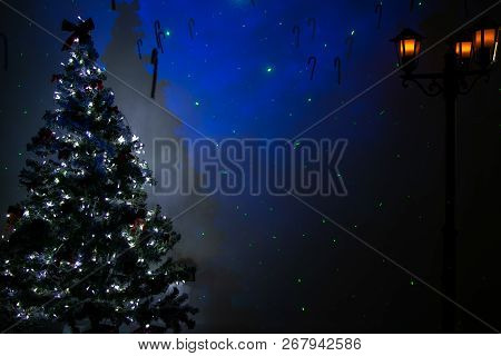 Festive Background Of Christmas Room With Tree, Lights, Street Lantern And Blue Stars