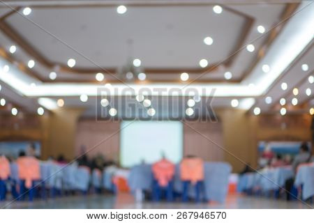 Behind Groub Audience Listening Speaker Speech In Conference Hall Or Seminar Room With Blur Light Pe
