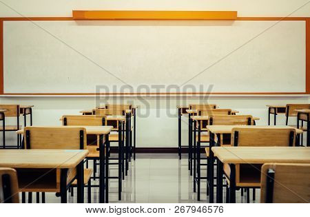 Back To School Concept. School Empty Classroom, Lecture Room With Desks And Chairs Iron Wood For Stu