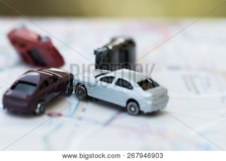 Vehicle Insurance Car Accident Concept :  Miniature Cars Accident Crash On Road, Broken Toys Auto Ca