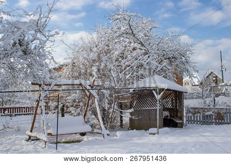 Morning Winter In A Country Yard, A Beautiful Winter Morning In The Resort, A Yard With A Swing And