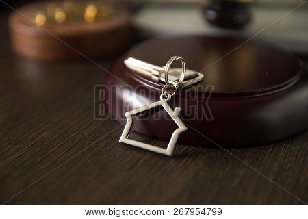 Judge Auctioneer Hammer, Door Key On Wooden Table. Concept For Court, Bankruptcy, Taxes, Mortgage, A