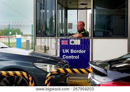 Calais, France - August 12 2018: Member Of The Uk Border Force Police Checking Cars As They Approach