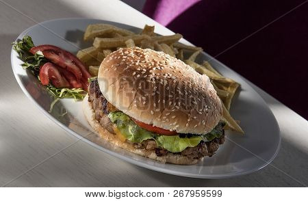 Delicious Hamburger And French Fries On A Plate