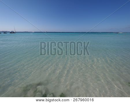 Symmetry view of turquoise waters of Caribbean Sea landscapes at Cancun city at Quintana Roo in Mexico, horizon line with clear blue sky in 2018 hot sunny winter day, North America on March. poster