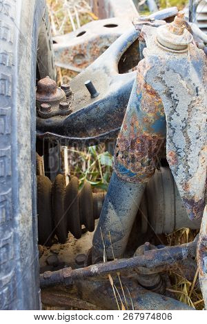 Old rusty chassis frame of an abandoned car poster