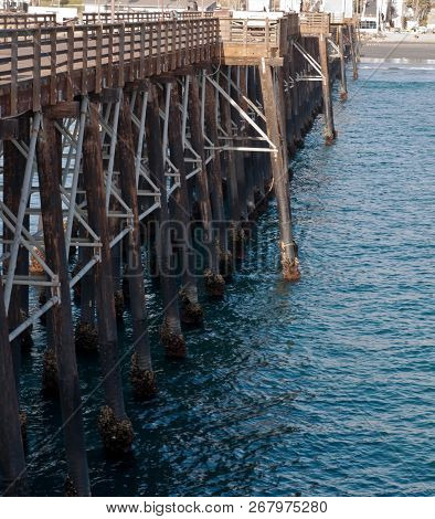 A Wooden Pier And The Pacific Ocean In Oceanside, California, Usa