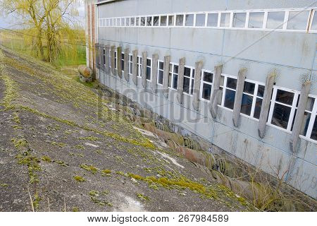 Outlet pipes of a water pumping station. Pipes of large diameter. wall, building poster