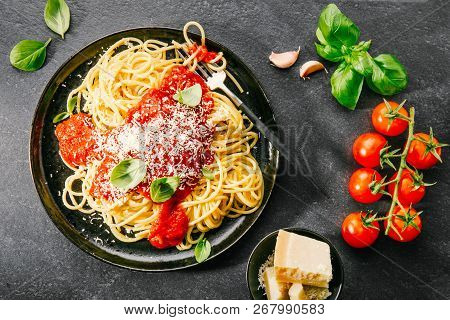 Pasta Spaghetti With Tomato Sauce And Cheese Parmesan Served On Dark Plate On Stone Table Background