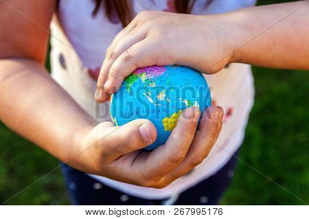 Earth Globe In Children Hands. Little Girl Holding Symbol World Map. Environment Conservation, Save