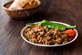 Turkish Street Food Kokorec with Tomato and Green Pepper. (Portion Sheep Bowel). Traditional Food. poster