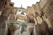 13th century temple enshrining, the largest Buddha image in Sukhothai, Thailand. Phra Achana in Wat Si Chum. poster