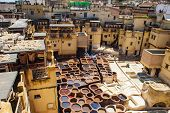Tanneries of Fes Old tanks with color paint for leather. Morocco Africa. poster