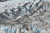 Mendenhall Glacier closeup on an overcast summer day showing the saturated blues of glacial ice. poster