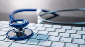 Medical Science Technology Concept. Blue Stethoscope On White Modern Keyboard On Doctor Desk. Health