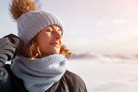 Portrait Beauty Woman Model On Winter Background. Beautiful Modern  Young Woman Wearing Blue Knittin