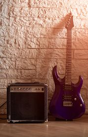 Guitar And Amplifier On A Stone Background