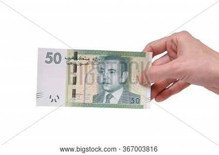 Female Hand Holding A 50  Moroccon Dirham Banknote Isolated On A White Background. Denomination Of 5