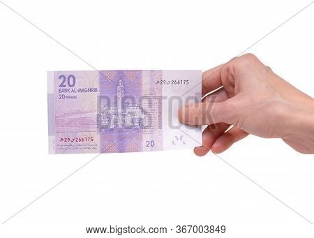 Female Hand Holding A 20  Moroccon Dirham Banknote Isolated On A White Background. Denomination Of 2