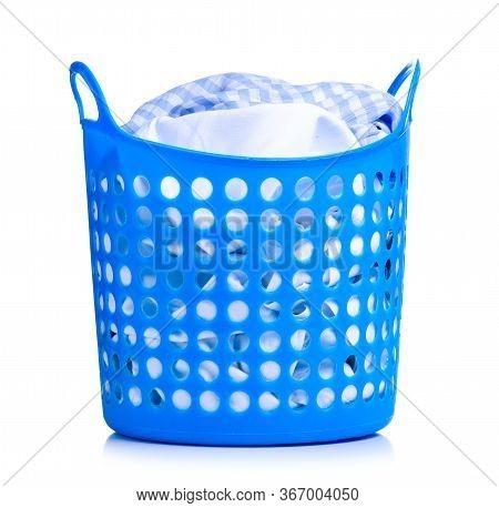 Blue Plastic Laundry Basket With Clothes Laundry On White Background Isolation