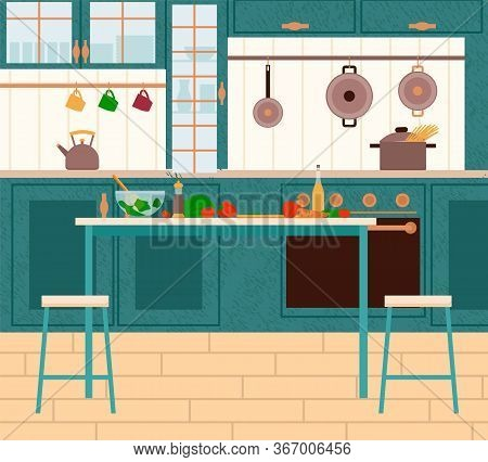 Cooking Furnished Place With Tomato And Bell Pepper On Table. Kitchen Interior View With Wooden Cupb