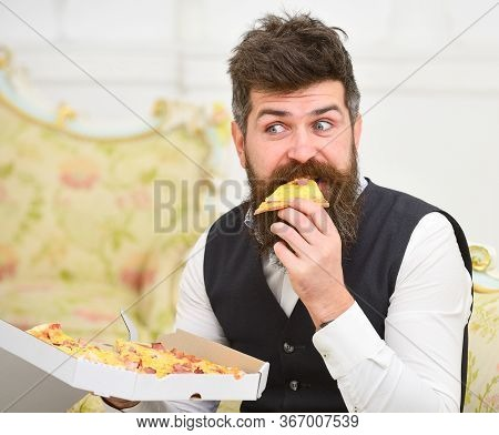 Pizza Delivery Concept. Man With Beard And Mustache Holds Box With Tasty Fresh Hot Pizza. Macho In C