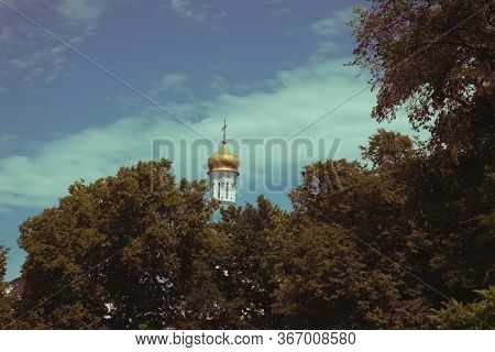The Dome Of The Orthodox Church Over The Trees. Golden Dome Against The Blue Sky. Autumn Landscape.