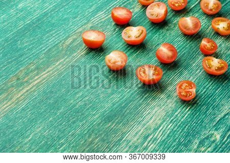 Fresh Ripe Organic Cherry Tomatoes On Green Wooden Background With Copy Space For Text.