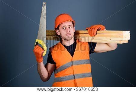 Carpenter, Woodworker, Labourer, Builder On Thoughtful Face Carries Wooden Beams On Shoulder. Man, H