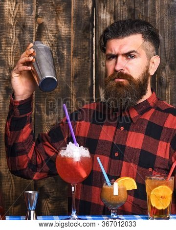 Barman And Cocktails Concept. Barman With Long Beard