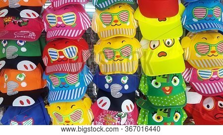 Pattaya, Thailand - March 2019. Colorful Children's Summer Caps With Drawings. Sun Protection. Summe