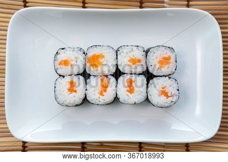 Hosomaki Thin Rolls, Simple Rolls, Small Rolls, With Salmon. Top View On A White Plate. Syake Maki C