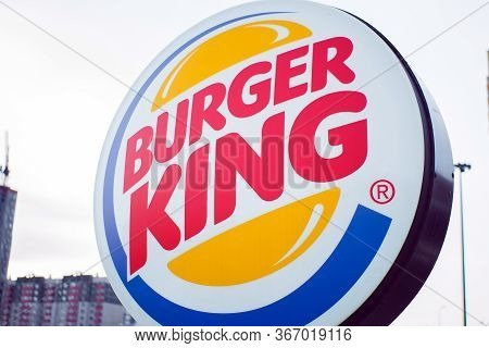 Tyumen, Russia-march 19, 2020: Burger King Restaurant Exterior-sign Near The Main Entrance Close-up