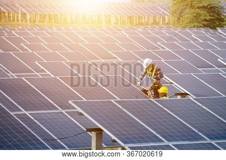Technician To Maintain Solar Cells To Produce Electricity From Solar Energy