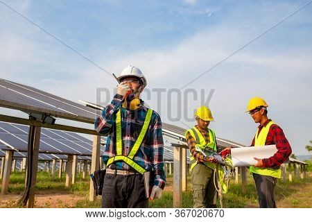 The Electrician Engineering Working In The Solar Cell Farm