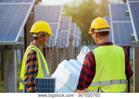 The Electrical Engineering Team Is Working In A Solar Panel Farm Or Repair Photovoltaic