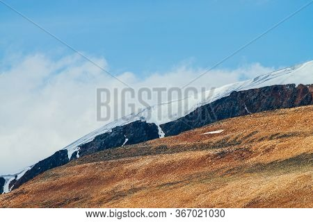 Awesome Vivid Stony Hill And Crag With Snow In Sunlight. Colorful Sunny Highland Landscape With Red