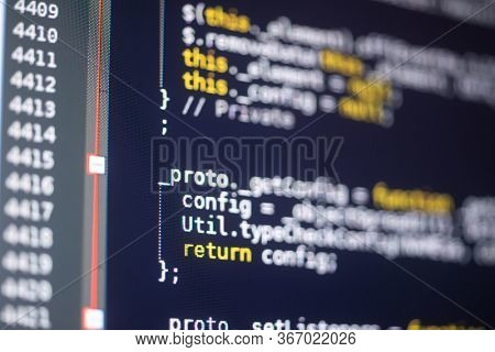 Javascript code on a monitor, programming concept