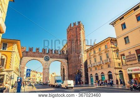Verona, Italy, September 12, 2019: Portoni Della Bra Gate With Merlons And Clock, Old Roman City Dou