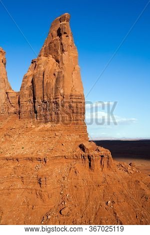 The USA. Monument Valley is a unique geological formation. Huge masses of red sandstone - outliers on the Navajo Indian Reservation. The famous cliffs Butte. The concept of photo tourism