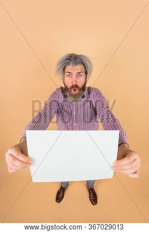 Advertising Board. Copy Space For Text. Surprised Man With Blank Board. Space For Text. Bearded Man