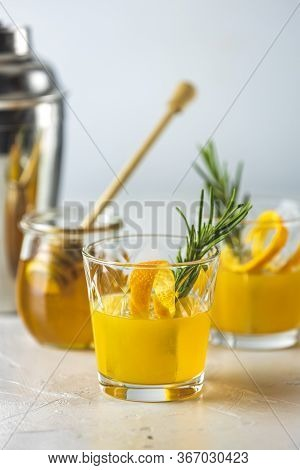 Honey Bourbon Cocktail With Rosemary Simple Syrup Or Homemade Whiskey Sour Cocktail Drink With Orang