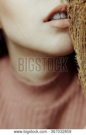 Large Portrait Of A Womans Lips And Neck. Her Lips Were Painted With Neutral Lipstick To Match Her S