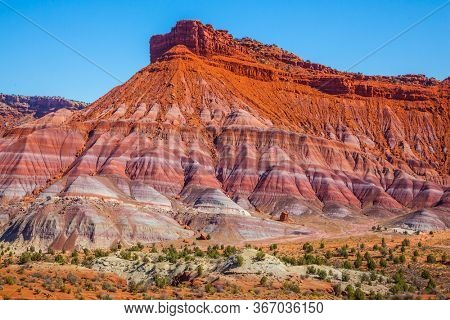 USA. Arizona, Utah. Paria Canyon-Vermilion Cliffs Wilderness Area. Picturesque spurs of red sandstone mountains. The concept of active, extreme and photo tourism