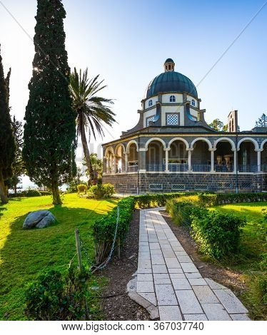 The Mount Bliss on the Sea of Galilee. Israel. Catholic Church of the Beatitudes of the Franciscan monastery. Blooming huge park around the monastery. The concept of religious pilgrimage