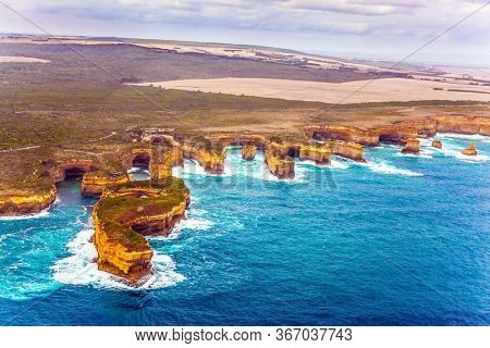 Australia, Port Campbell Park. Great Ocean Road and coastal cliffs of the Twelve Apostles is a group of limestone cliffs. The concept of  photo tourism. Picture taken from a helicopter