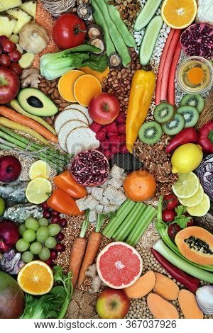 Large collection of immune boosting healthy food for fitness & energy with foods high in antioxidants, anthocyanins, vitamins, minerals, protein, omega 3, smart carbs, lycopene & fibre. Flat lay.